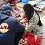 "Dr. Joha attends to a displaced woman at Al-Hol Camp. The needs were ""overwhelmingly high,"" he said. © UNFPA Syria"